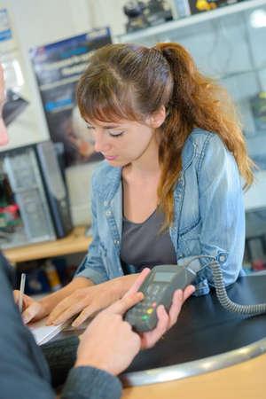 Photo pour Customer entering code on card payment machine - image libre de droit