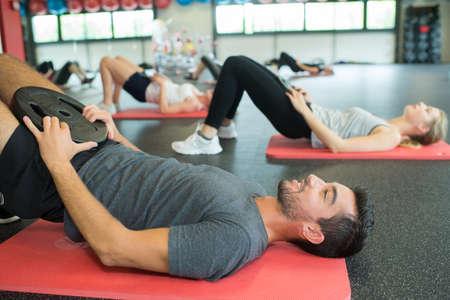 Photo pour Exercise class doing a pelvic lift - image libre de droit