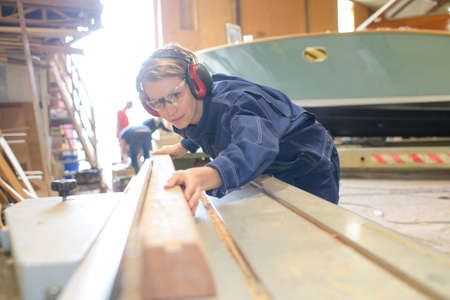 Foto per female ship builder at work - Immagine Royalty Free
