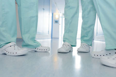 Photo pour close up shoes of medical team in hospital corridor - image libre de droit