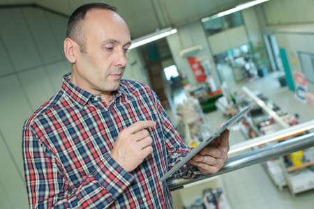 Photo pour businessman with tablet analyzing stock at logistics port - image libre de droit