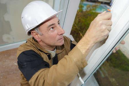 Foto de worker checking the newly installed window - Imagen libre de derechos