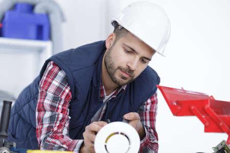 Photo pour Workman with air vent - image libre de droit