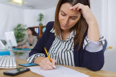 Photo pour depressed woman in the office - image libre de droit