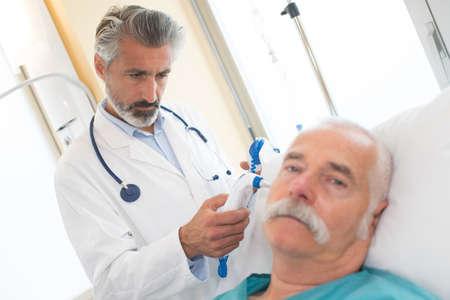 Photo pour male doctor with senior man in hospital - image libre de droit