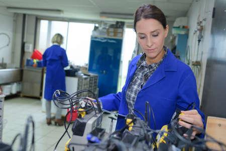 Photo pour female mechanical workers at a workshop - image libre de droit