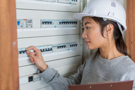 Photo for female electrician working on fuse board - Royalty Free Image