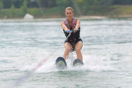 Photo for young woman doing water skiing - Royalty Free Image
