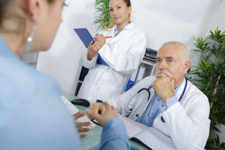 Photo pour doctor and patient are discussing something - image libre de droit