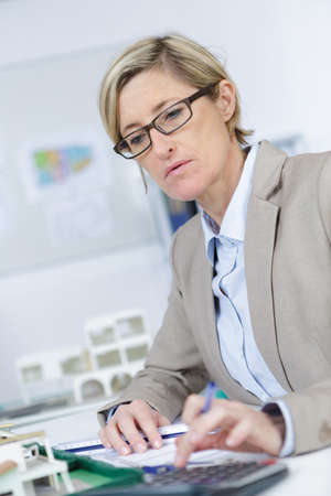 Photo pour woman accountant calculating taxes - image libre de droit