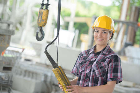 Photo for portrait of female worker holding winch controls - Royalty Free Image