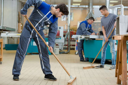 Foto de group of workers cleaning factory - Imagen libre de derechos