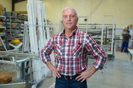 Photo pour portrait of mature male worker in window manufacturing company - image libre de droit