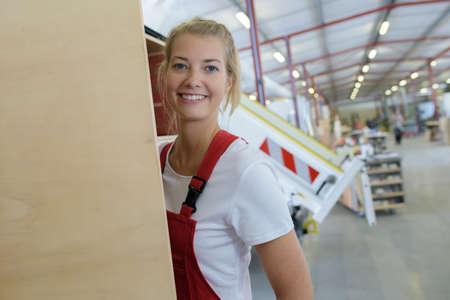 Photo pour happy woman working in wood factory - image libre de droit
