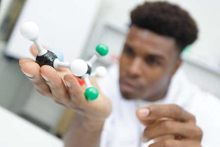 Photo pour scientist holding plastic model molecule - image libre de droit