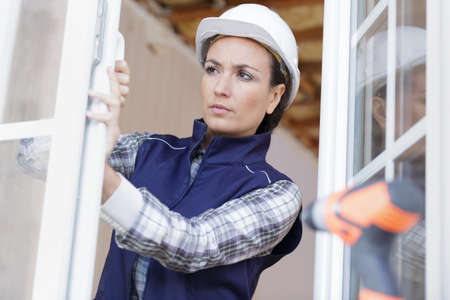 Photo pour a woman designer supervising window - image libre de droit
