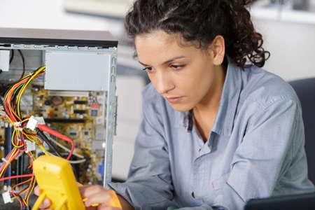 Photo pour a woman with voltage measuring - image libre de droit