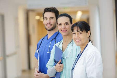 Photo pour team of doctors standing in the hospital corridor - image libre de droit