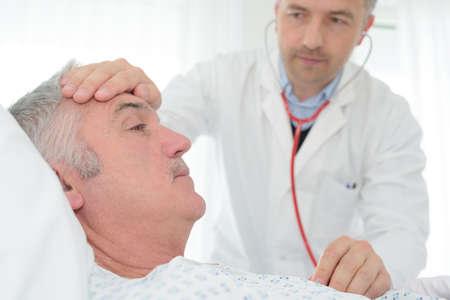Photo pour senior doctor visiting senior patient - image libre de droit