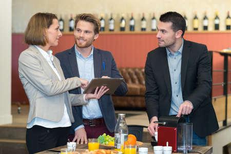Photo pour businesswoman is using a tablet while business lunch - image libre de droit