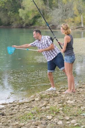 Photo pour couple fishing - image libre de droit