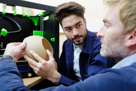 Photo pour Team of designers making vase with 3d printer - image libre de droit