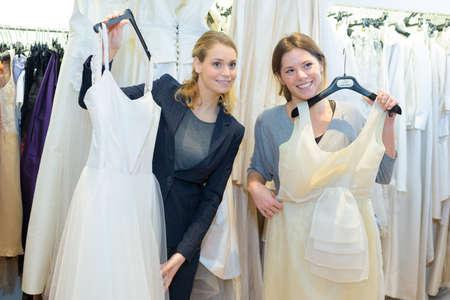 Photo pour portrait of women and choice of gowns - image libre de droit