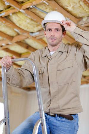 Photo pour a construction worker on a ladder - image libre de droit