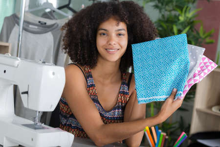Photo pour a seamstress holding fabric choices - image libre de droit