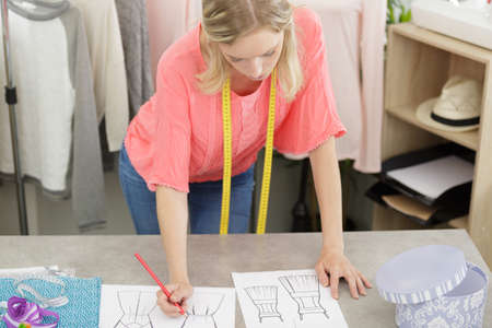 Photo pour young female fashion designer sketching dress - image libre de droit