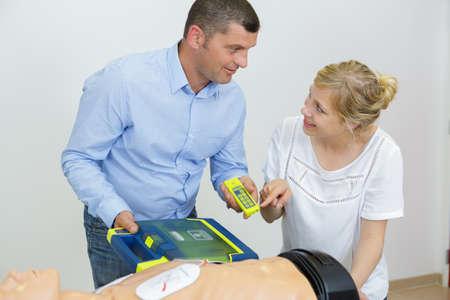 Photo pour hand heart pump with medical dummy on cpr - image libre de droit