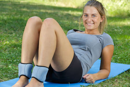 Photo pour woman wearing ankle protection while doing exercise - image libre de droit