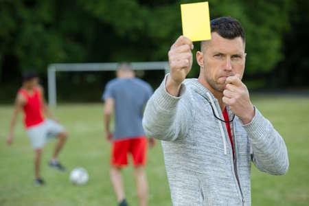 Photo pour a referee showing yellow card - image libre de droit