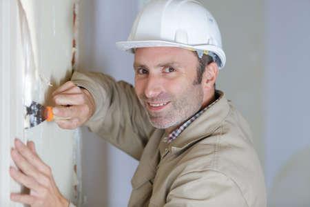 Photo pour worker making repair in room - image libre de droit