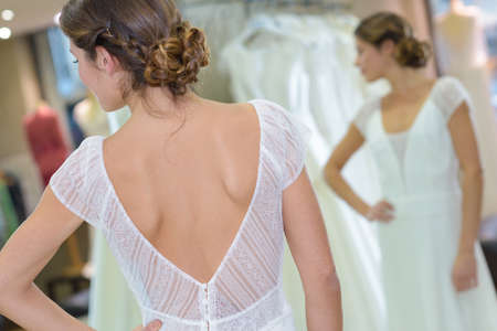Photo pour female trying on wedding dress in a shop - image libre de droit