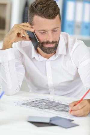 Photo pour Professional man on phone in office - image libre de droit