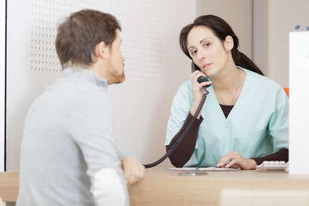 Photo pour patient with woman doctor on the phone - image libre de droit