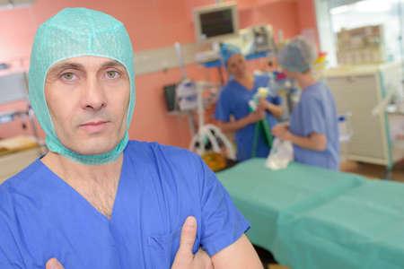 Photo pour portrait of surgeon with medical reports at hospital - image libre de droit