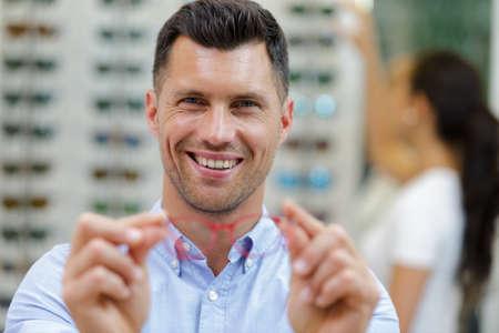 Photo pour portrait of a happy businessman trying out glasses - image libre de droit