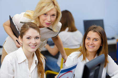Photo pour portrait of female students with teacher - image libre de droit