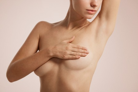 Photo pour Closeup cropped portrait young woman with breast pain touching chest colored isolated on background - image libre de droit