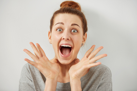 Photo for Surprise astonished woman. Closeup portrait woman looking surprised in full disbelief wide open mouth isolated grey wall background. Positive human emotion facial expression body language. Funny girl - Royalty Free Image