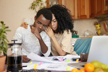 Photo pour No money. Depressed desperate bankrupt young dark-skinned family feeling financial stress while reading notification, informing about eviction from their house because of non-payment for rent - image libre de droit