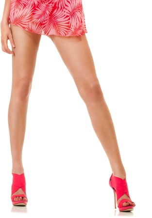 Sexy long female legs isolated over white background