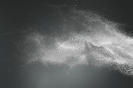 Foto de Abstract design of white powder cloud against dark background - Imagen libre de derechos