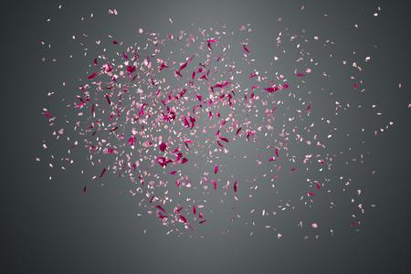 Photo pour Pink flower petals failing down on dark background - image libre de droit