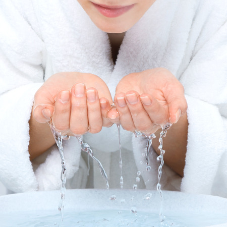 Photo for Young woman washing face with clean water - Royalty Free Image