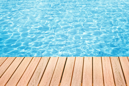 Photo for Abstract design of swimming pool water and wooden desk with space for text - Royalty Free Image
