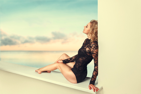 Photo for Beautiful young woman relaxing in tropical sea resort - Royalty Free Image