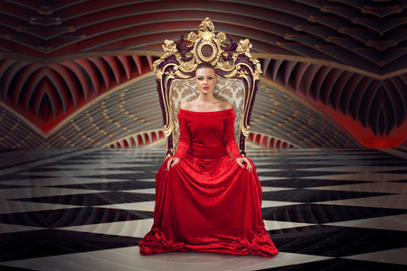 Photo pour A woman in a luxurious gown dress sitting on a queen's throne - image libre de droit
